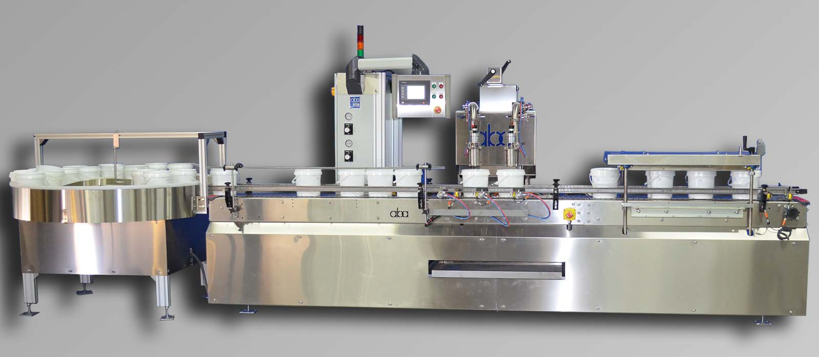 M327-2 top fill, 2 head volumetric machine with swing frame, rotary infeed table, and roller lid press