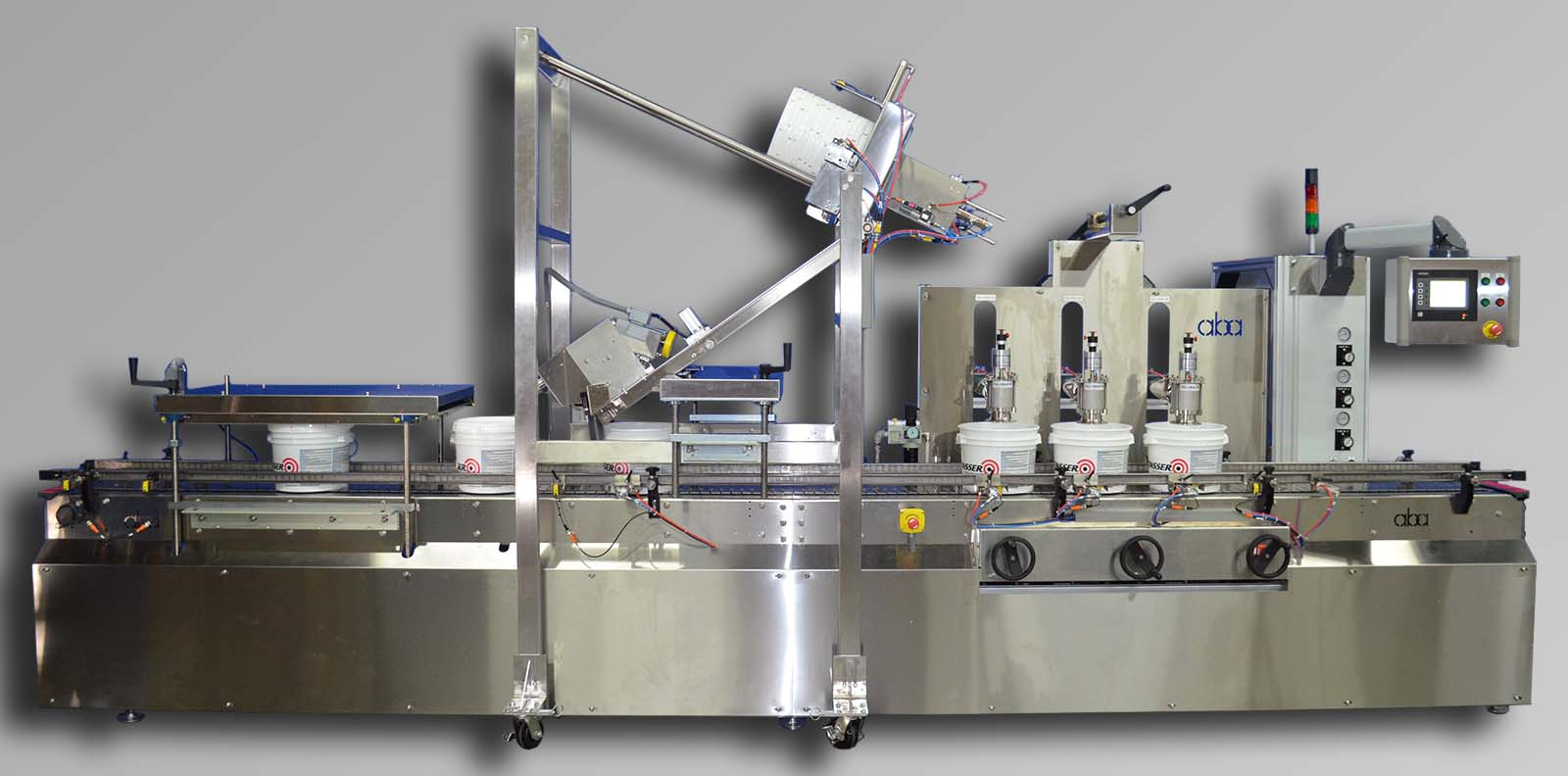 Top fill, 3 head volumetric paint filling machine with lid placer and roller lid press