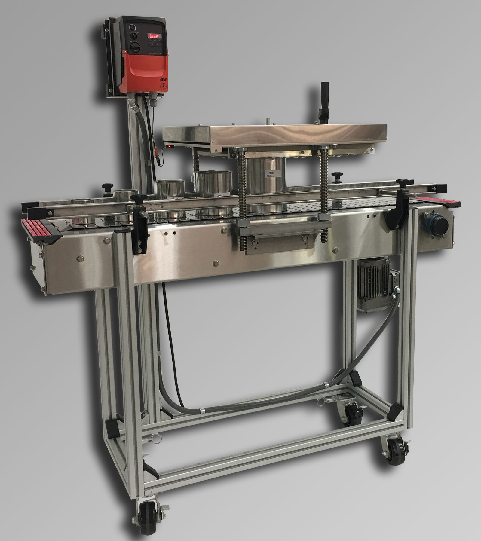 ABA-M436 - 1 gallon roller lid press and conveyor