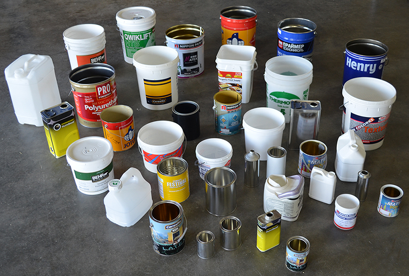 Various paint and chemical containers